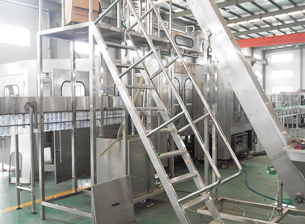 Carbonated beverage filling line, with cap lifter & cap disinfection tunnel